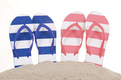 Flip-flops in sand Royalty Free Stock Photos