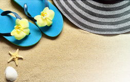 Flip Flops in the sand with starfish . Summertime .beach concept. Royalty Free Stock Image
