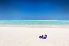 Flip-flops on sand on tropical beach in Maldives Stock Images