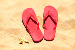 Flip-flops on a sand Royalty Free Stock Images