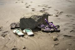 Flip flops and sandals on the beach Royalty Free Stock Images