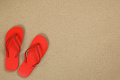 Flip Flops sandals in sand summer vacation with copyspace Stock Photo