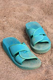 Flip-flops on a sandy beach Stock Photos