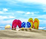 Flip flops on the sandy beach Stock Photos
