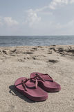 Flip-flops on a sandy beach in summer Royalty Free Stock Photography