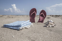 Flip-flops on a sandy beach in summer Royalty Free Stock Images