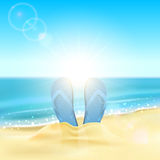 Flip flops on the sandy beach Royalty Free Stock Images
