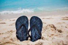 Flip flops on the sandy ocean beach in Cancun , tropical vacatio Stock Photos