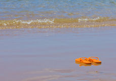 Flip flops by the sea shore Stock Photography