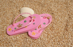 Flip flops on shingle beach Royalty Free Stock Photography