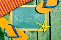 Flip-flops, starfish and chalkboard with the word verano, summer Royalty Free Stock Photography
