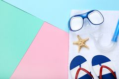 Flip flops with starfish and diving mask. On colorful background stock photography