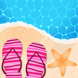 Flip-flops and starfish by the seaside Stock Images