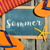 Flip-flops, starfish and text sommer, summer in German Stock Photo