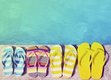 Flip flops on stone background. On poolside. Summer family vacation concept stock photos