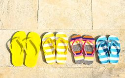 Flip flops on stone background. Summer vacation concept stock photography