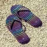 Flip-flops on stony beach Royalty Free Stock Photos
