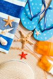 Flip flops, straw hat, starfish, sunscreen bottle, body lotion spray on wooden background top view . flat lay summer beach sea. Accessories background, travel royalty free stock photography