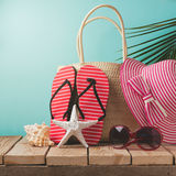 Flip flops and summer bag on wooden table. Summer holiday concept Royalty Free Stock Images