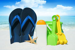 Flip Flops, Sun cream and Beach Toys Stock Photography