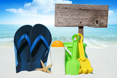 Flip Flops, Sun cream and Beach Toys Stock Photos