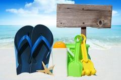 Flip Flops, Sun cream and Beach Toys Stock Photos