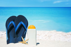 Flip Flops and sun cream Royalty Free Stock Photos