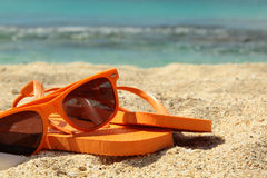 Flip flops and sun glasses Royalty Free Stock Image