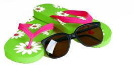 Flip Flops and Sunglasses. Colorful flip flops with dark sunglasses nearby royalty free stock photography