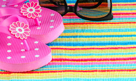 Flip flops and sunglasses Royalty Free Stock Images