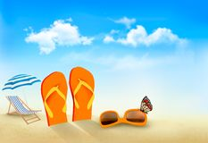 Flip flops, sunglasses, beach chair and a butterfl Royalty Free Stock Photography