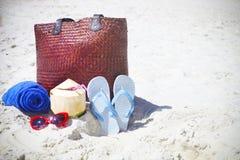 Flip flops, sunglasses, beach towel with beach bag and coconut c Royalty Free Stock Photos