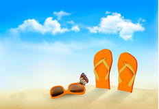 Flip flops, sunglasses and a butterfly on a beach. Stock Photography