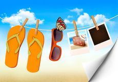 Flip flops, sunglasses and photo cards hanging on  Royalty Free Stock Images
