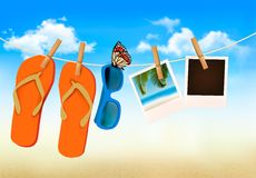 Flip flops, sunglasses and photo cards hanging on  Stock Photo
