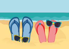 Flip-flops and sunglasses on the sandy shore of the ocean. Vector Royalty Free Stock Photo