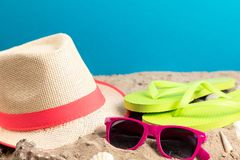 Flip flops with sunglasses and strand hat. Flip flops with pink sunglasses and strand hat royalty free stock photography