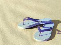 Flip flops on sunny beach. Pair of light blue flip flops on beach, close to sundown stock illustration