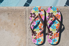 Flip-flops by the swimming pool Stock Photo
