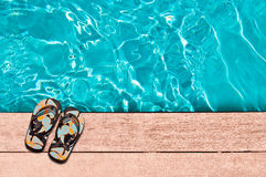 Flip flops and swimming pool Royalty Free Stock Photos