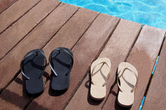 Flip flops by the swimming pool. Flip flops at swimming pool from the family stock photography