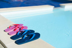 Flip flops at swimming pool Stock Images