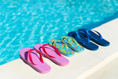 Flip flops at swimming pool. Flip flops for him and her at the swimming pool royalty free stock image