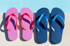Flip flops at swimming pool Royalty Free Stock Images