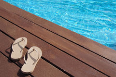 Flip flops by the swimming pool Royalty Free Stock Image