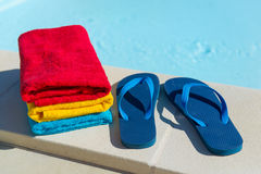 Flip flops at swimming pool Stock Photography