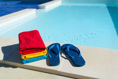 Flip flops at swimming pool Royalty Free Stock Image