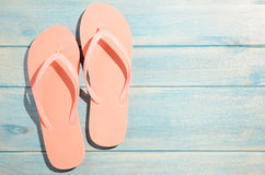 Flip flops on table Stock Images
