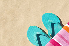 Flip flops and towel. Location shot of a brightly coloured towel and a pair of thongs/flip-flops Stock Photo