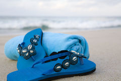 Flip flops and towel on a beach Royalty Free Stock Photography
